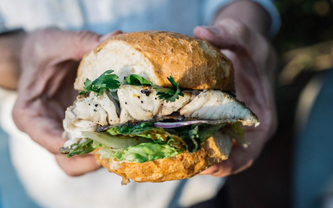 BBQ barramundi burger with grilled cos, grilled lemon and jalapeno tartare