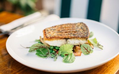 Pan-roasted barramundi with bacon, mushrooms and peas