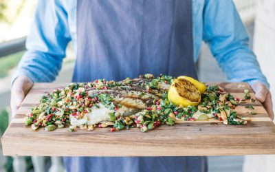 BBQ barramundi with pomegranate and green olive tabbouleh