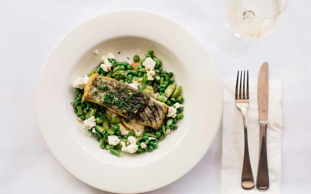 Pan fried barramundi with yoghurt, peas and asparagus