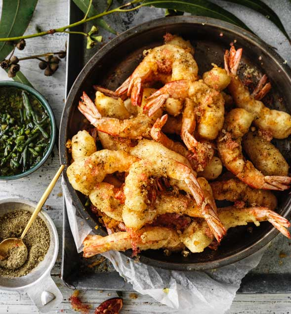 Bush fennel fried prawns with finger limes and samphire salsa