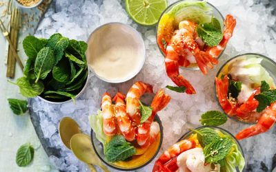 Mango and lime prawn cocktails with sesame seeds on ice
