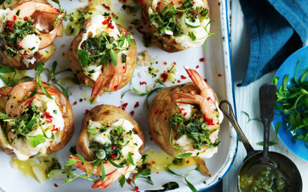 Salt baked potatoes topped with jalapeño butter and prawns